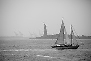 A sailboat passes in front of Liberty Island. Industrial cranes can be seen in the background.<br /> <br /> All posters are self-fulfilled. Prices vary depending on poster size and quality. Delivery is usually &pound;3.75.