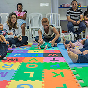 Specialized doctors teach exercises techniques to visually stimulate children with microcephaly at the rehabilitation center FAV (Fundação Atilio Valente) in Recife, Pernambuco
