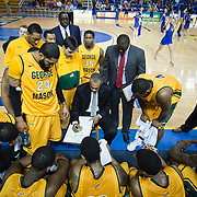 02/01/12 Newark DE: George Mason Men's Head Coach Paul Hewitt (Center) draws up a play during a time out in the second half a Colonial Athletic Association conference Basketball Game against Delaware Wed, Feb. 1, 2012 at the Bob Carpenter Center in Newark Delaware.