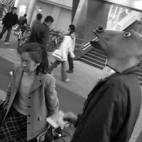 A man wearing a horse head mask, near the horse racing track at Nishi-Funabashi, Tokyo, Japan.