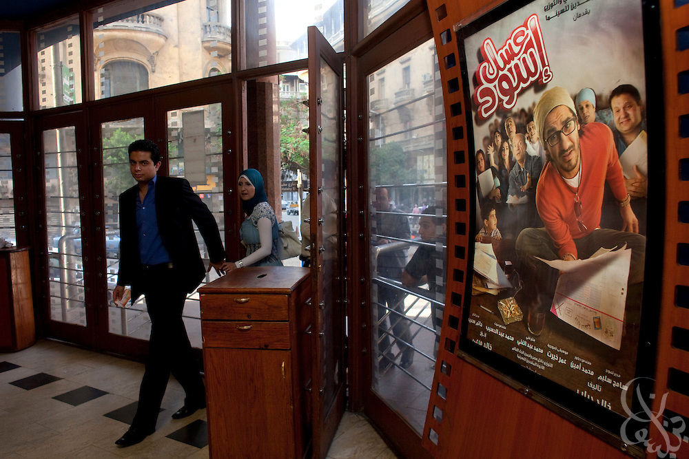 "Egyptian movie fans enter a theater June 15, 2010 to see the recently released film by Egyptian comedy star Ahmed Helmy entitled ""Asal Eswed"" (literally translated, ""Black Honey"") in downtown Cairo, Egypt. The film is a social satire that tackles  issues of national identity. (Photo by Scott Nelson for the National)"