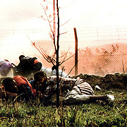 South Africa, Bisho 1992..ANC supporters flee towrads the South African side of the border with the aprtheid homeland of Ciskei after they were fired on and 29 marchers who were killed and dozens more wounded  - some inside South Africa, September 7, 1992 after an ANC march on the Ciskei homeland.  The ANC supporters were killed when Ciskei security forces opened fire after the marchers broke through the border in an attempt to march on aforce the Ciskeien military leader Brigadier Oupa Gqozo to allow free political activity in Ciskei. .Photograph by Greg Marinovich