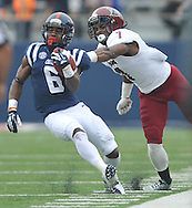 Mississippi running back Jaylen Walton (6) is grabbed by Troy safety Chris Pickett (7) at Vaught-Hemingway Stadium in Oxford, Miss. on Saturday, November 16, 2013. (AP Photo/Oxford Eagle, Bruce Newman)