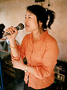 """Singer at Lao """"naming"""" ceremony for newborn child."""