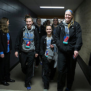 03/21/2014- Stevens Point, Wisc. - Liz Moynihan, A14, left, Kelsey Morehead, A15, and Michela North, A17, make their way through the tunnel past the NCAA committee to their locker room before their NCAA Division III Women's Final Four game on Mar. 21, 2014. (Kelvin Ma/Tufts University)
