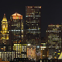 Downtown Boston panorama skyline photography images showing landmarks such as Vertex Pharmaceuticals, Converse headquarters, Custom House of Boston, Zakim Bridge, One International Place, TD Bank North Garden, Vertex Pharmaceutical, Convers Headquarter photographed on a stunning night shortly after sunset. This Boston panorama skyline photo image is available as museum quality photography prints, canvas prints, acrylic prints, wood prints or metal prints. Wall art prints may be framed and matted to the individual liking and decor needs: <br />