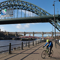 Cyclist in Newcastle on the quay of the river Tyne, Great Britain.