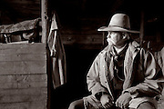 WY02428-01....WYOMING - Mike Buckich in the barn at the Willow Creek Ranch. MR# B18