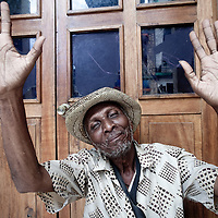 A man raises his hands in Les Cayes on the Tiburon Peninsula, Haiti