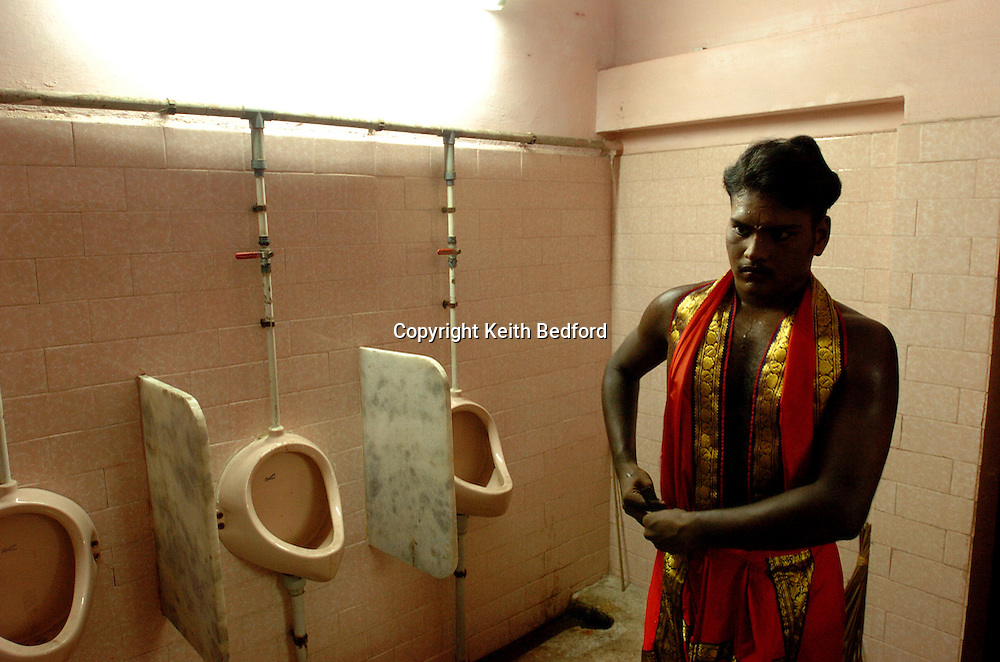 Transvestites preparer to marry the god Aravan to celebrate the Aravani festival in the town of Koovagam in the Tamil Nadu state of India April 20, 2005. After being symbolically married to the god for one night, those that participate are widowed the next morning. The festival, popular among Indian transvestites, celebrates myth of the marriage of the Hindu Lord Aravan to Lord Krishna, who transformed himself into a woman as a reward to Aravan for sacrificing himself to ensure victory during war.<br />