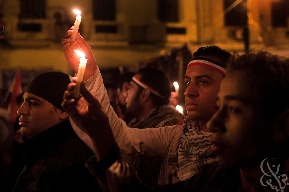 Egyptian protesters march with candles during a February 09, 2011 candlelight vigil for victims of the 2 week long Egyptian uprising against the Hosni Mubarak regime in Tahrir Square in downtown Cairo, Egypt. Human Rights groups claim close to 300 people have lost their lives so far during the unprecedented and widespread protests across Egypt that threaten to topple the nearly 30 year old regime of Mubarak. (Photo by Scott Nelson).