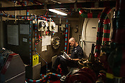 A crew member studies in a quiet corner of the ship<br /> <br /> Aboard the USS Harry S. Truman operating in the Persian Gulf. February 25, 2016.<br /> <br /> Matt Lutton / Boreal Collective for Mashable
