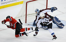 Feb 26, 2009; Newark, NJ, USA; Colorado Avalanche defenseman Adam Foote (52) trips New Jersey Devils right wing David Clarkson (23) during the first period at the Prudential Center.