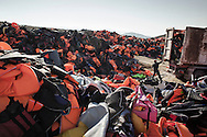 A truck dump a full load of life jackets collected on Lesbos shores in a waste yard near Molivos, Greece on 12 November, 2015. Lesbos, the Greek vacation island in the Aegean Sea between Turkey and Greece, faces massive refugee flows from the Middle East countries.