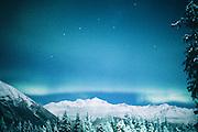 Alaska. Northern Lights with Big Dipper over Chugach Mts.