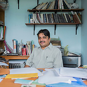 Pastor Tanka Prasad at his office in Patan, Kathmandu, Nepal