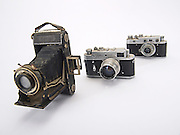 three rangefinders cameras on white background