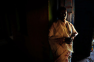 An Indian Christian woman prays prior to Good Friday services at a camp for displaced Christians April 10, 2009 in the town of Mondesore in the state of Orissa, India. Tensions remain high in the area several months after violence by Hindu fundamentalist towards the Christian minority  forced thousands from their homes and leaving several churches and homes destroyed.