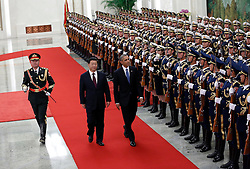 epa04485876 US President Barack Obama (3-L) and Chinese President Xi Jinping (2-L) review honor guards during a welcome ceremony at the Great Hall of the People (GHOP) in Beijing, China, 12 November 2014. Obama is in China to attend the Asia-Pacific Economic Cooperation (APEC) 2014 Summit and related meetings.  EPA/HOW HWEE YOUNG  EPA/HOW HWEE YOUNG
