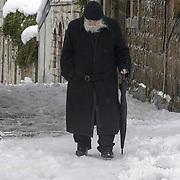 An Israeli old man walk during snow storm in Jerusalem. December 13, 2013.  Photo by Oren Nahshon