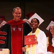 Red Lion Christian Academy candidates for graduation Nicole Robinson receives her diploma during commencement exercise Friday, May 29, 2015, at Glasgow Church in Bear, Delaware.