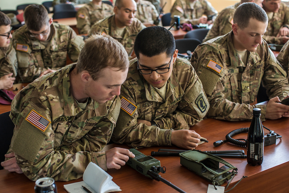 YAVORIV, UKRAINE - APRIL 30, 2015: After spending the morning teaching their Ukrainian counterparts how to use new communication radios provided by the United States for the Ukrainian army, members of the U.S. Army's 173rd Airborne Brigade act as students while the Ukrainians teach the radio's operation back to them as part of Operation Fearless Guardian at the Yavoriv training center near Yavoriv, Ukraine. Around 300 American soldiers are training an equivalent number of Ukrainians during each of three eight-week programs to improve their ability to combat Russian-backed rebels in the country's east. CREDIT: Brendan Hoffman for The New York Times