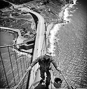 San Francisco Golden Gate Bridge painter walking up main cable, 1947