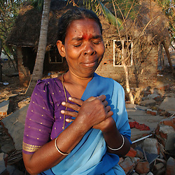 Praviti cries outside the remains of her home after she lost 2 relatives in the deadly tsunamis that ravaged the coast of India and Asia January 5, 2005 in Cuddalore in the state of Tamil Nadu. 15,000 people died in India alone and hundreds of thousand were made homeless. (Ami Vitale)