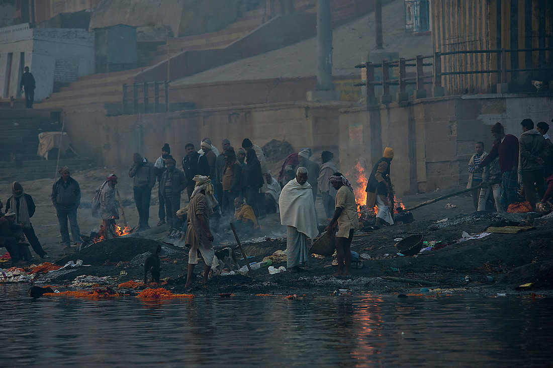 Fires burn at one of the cremation grounds along the Ganges river on January 31, 2013 in Varanasi, India. Cremation is seen as the spiritual essence of an individuals release from the physical body hence the cycle of rebirth and death can continue. Some Hindus believe that death at Varanasi brings salvation. — © Jeremy Lock/