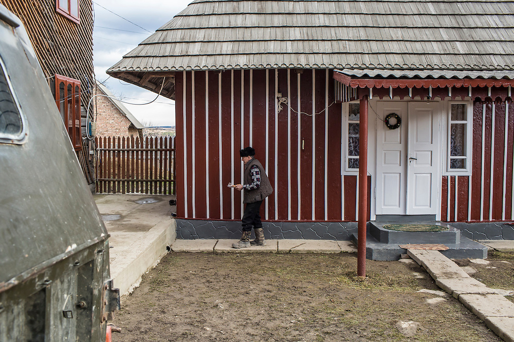 "Dmytro Dragun, 82, outside his house as his family prepares to celebrate the Malanka Festival on Wednesday, January 13, 2016 in Krasnoilsk, Ukraine. The festival begins at sundown and will last until the following evening. ""I don't know when Malanka appeared, before Jesus or after,"" he said."