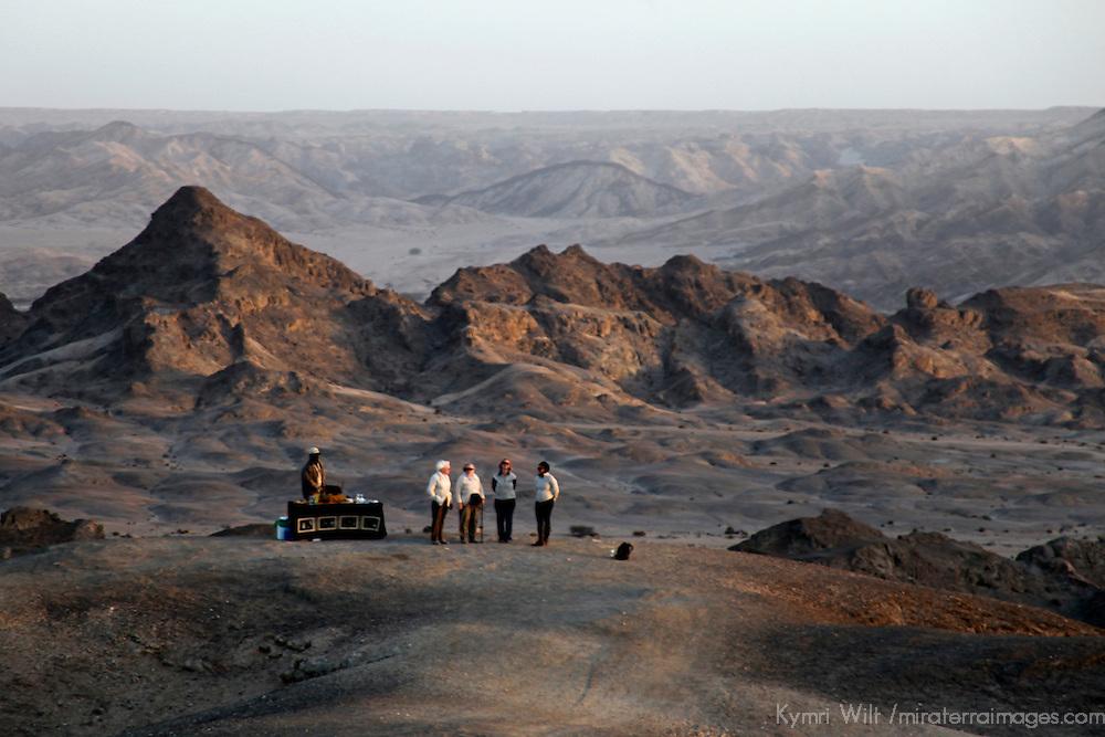 Africa, Namibia, Swakopmund. Sundowner in the Moon Landscape of Namib Desert east of Swakopmund.