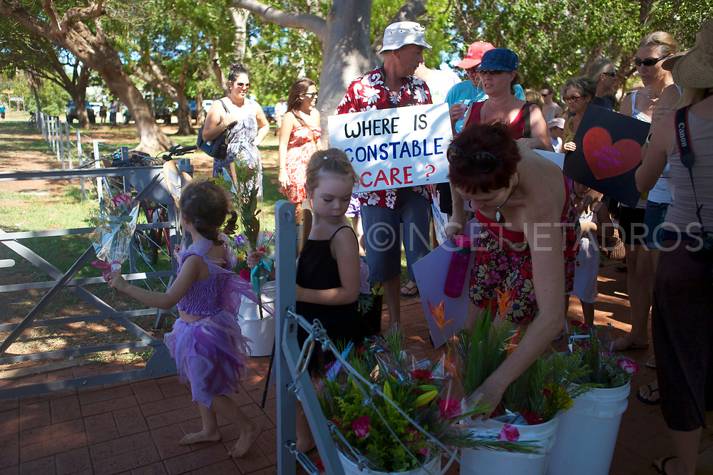 """Broome's Community is Celebrating Mothers Day at the Courthouse Markets in Broome . A silent gathering showing concerns about the numbers of police positioned in town and the proposed gas Hub at James Price Point. People offered flowers to the Police Officers inside the police station to give to their mothers. """"We are the families of Broome residents, we are not professional protesters, and we are concerned about what is coming."""" Broome, WA"""