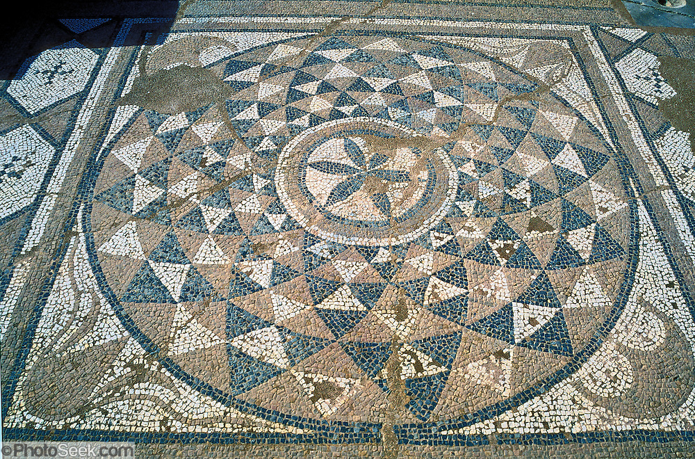 At Litohoro, Greece, see a circular mosaic with triangular patterns dating from 200 AD at the Roman Baths at Ancient Dion which, at the foot of Mount Olympus, was the sacred city of the Macedonians, who worshipped Olympian gods.