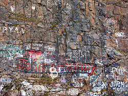 graffiti painted on a rock face along rural highway SR9 in WA near LaGrand, WA above the Nisqually River Canyon. Washington state, USA