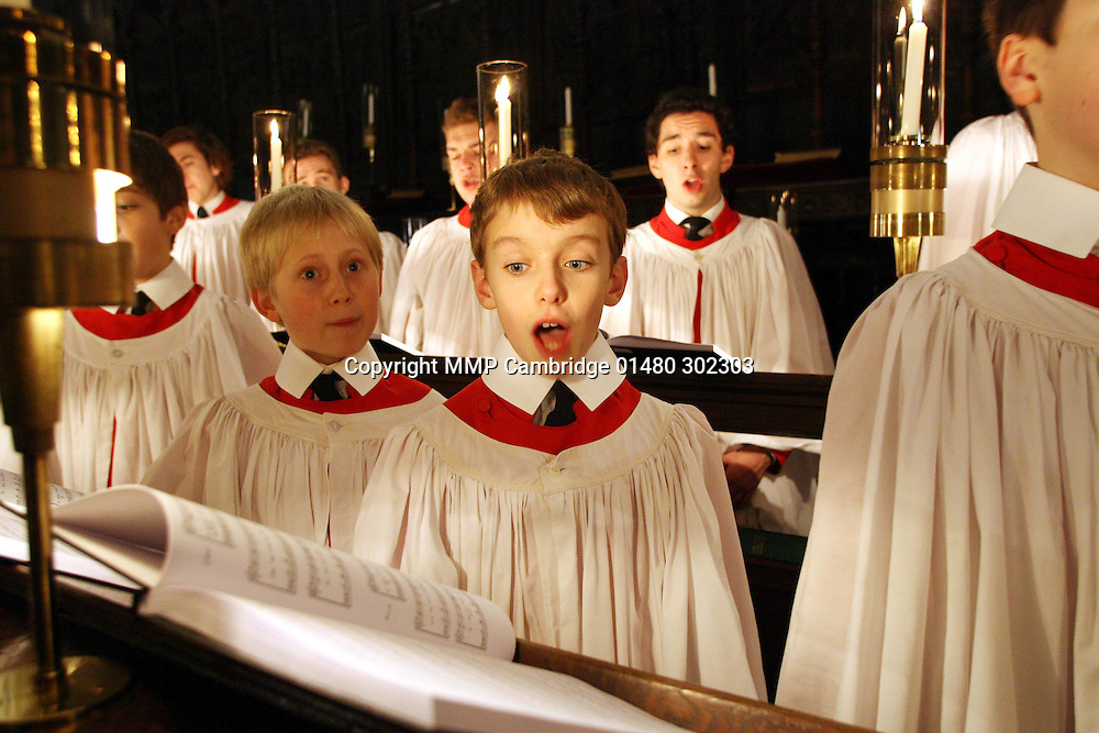 THE CHOIR REHEARSING FOR THE CHRISTMAS EVE PERFORMANCE AT KINGS COLLEGE,CAMBRIDGE....The world famous King's College Choir will be singing its traditional Festival of Nine Lessons and Carols this Christmas Eve and with it marking a landmark anniversary in its history...It is now a quarter of a century that Choral Director Stephen Cleobury has led the choir...Stephen, 58, has led the choir's demanding schedule of daily performances and recitals around the world and also established a tradition of encouraging the development of new Christmas music...Each year he has commissioned a new Christmas carol from a leading British composer...This year Mark-Anthony Turnage has written Misere Nobis for the choir which will get its premier at the service on Christmas Eve...Such is the sacred position of the service in the Christmas calendar members of the public traditionally queue for up to two days to secure their seat in the Cambridge chapel to hear the service live...SEE MASONS COPY