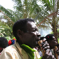 """Playing music through pipes as a procession starts at the beginning of """"school closing"""" festivities, on Han Island, Carterets Atoll, Papua New Guinea, on Monday, Dec. 11, 2006."""
