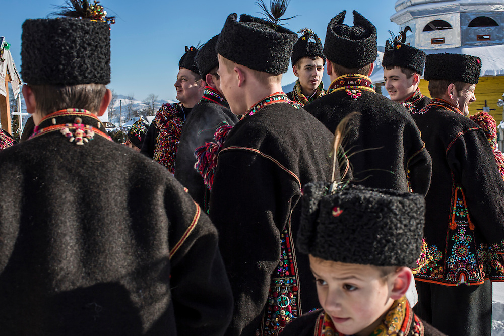 ILTSI, UKRAINE - JANUARY 7: Men wearing traditional Hutsul clothing gather at Holy Trinity Church to celebrate the Orthodox Christmas on January 7, 2015 in Iltsi, Ukraine. The men will gather in groups and travel house to house over the next twelve days singing songs until they've visited every home in the village. (Photo by Brendan Hoffman/Getty Images) *** Local Caption ***
