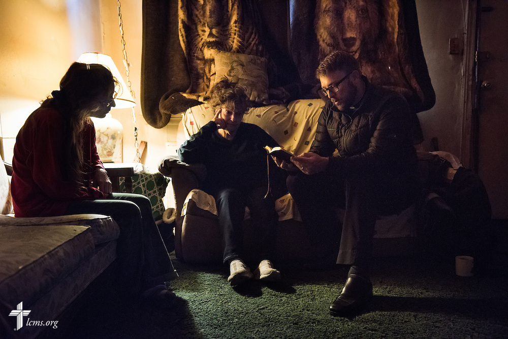 """The Rev. Adam DeGroot, new national missionary and pastor at Shepherd of the City Lutheran Church, a church plant and focus of Philadelphia Lutheran Ministries, reads Holy Scripture with Kayla """"Keke"""" Hiemenz (left) and Mildred Williams during a home visitation on Monday, Nov. 2, 2015, in Philadelphia.  LCMS Communications/Erik M. Lunsford"""