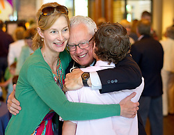 Sheila and Colter Sanders give a farewell hug to pastor Paul Hayden, center, at the Presbyterian Church of Jackson Hole on Sunday morning. Hayden is moving on after 20 years of leading the church he helped build.