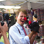 A traveling journalist in Tampa for the Republican National Convention takes a hit while playing with a Mitt Romney punching doll.
