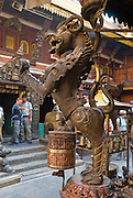 """A fierce dragon horse sculpture stands proudly at Golden Temple (Hiranya Varna, or Suwarna Mahavihara), a Buddhist Monastery existing since 1409 or earlier, located just north of Patan's Durbar Square, in Nepal, Asia. Patan was probably founded by King Veer Deva in 299 AD from a much older settlement. Patan, officially called Lalitpur, the oldest city in the Kathmandu Valley, is separated from Kathmandu and Bhaktapur by rivers. Patan (population 190,000 in 2006) is the fourth largest city of Nepal, after Kathmandu, Biratnagar and Pokhara. The Newar people, the earliest known natives of the Kathmandu Valley, call Patan by the name """"Yala""""  (from King Yalamber) in their Nepal Bhasa language. UNESCO honored Patan's Durbar Square (Palace Square) as one of the seven monument zones of Kathmandu Valley on their World Heritage List in 1979. All sites are protected under Nepal's Monuments Preservation Act of 1956."""