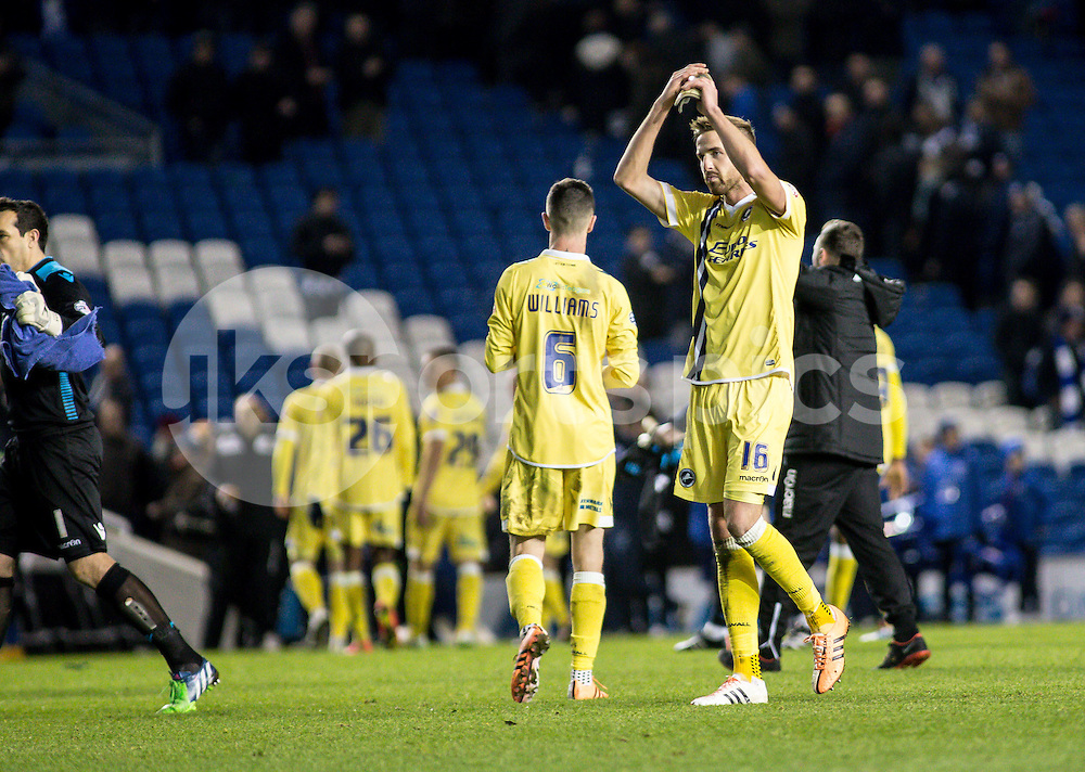 Mark Beevers of Millwall thanks the travelling fans during the Sky Bet Championship match between Brighton and Hove Albion and Millwall at the AMEX Stadium, Brighton, England on 12 December 2014. Photo by Liam McAvoy.