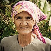 An elderly Vietnamese woman smiles at the Fairy Springs, Mui Ne, Vietnam, Southeast Asia.