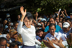 The National League of Democracy (NLD) head, Pro-democracy leader Aung San Suu Kyi is mobbed by supporters while giving them an impropmtu walk-around after she registered to run as a candidate in a by-election, for the  parliamentary seat in Kawhmu, in polls on April 1st, 2012. Thanlynn Electoral Commission Office, January 18, 2012....