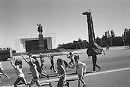 Eight years after the country declared its independence, in 1991,  from the Soviet Union a statue of Lenin looks over preparations for National Childrens day celebrations in  Ala-Too Square, formerly Lenin Square, in the capital city of Bishkek,  Kyrgyzstan.