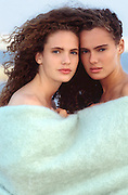 two woman wrapped in a blanket outdoors