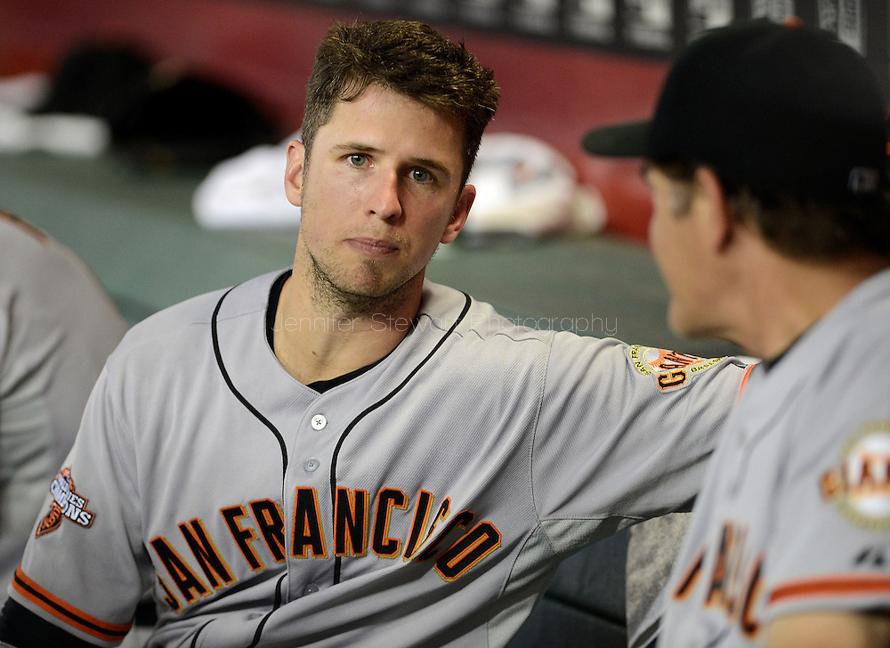 PHOENIX, AZ - JUNE 07:  Catcher Buster Posey #28 of the San Francisco Giants talks on the bench with pitching coach Dave Righetti #33 during the game against the Arizona Diamondbacks at Chase Field on June 7, 2013 in Phoenix, Arizona.  (Photo by Jennifer Stewart/Getty Images) *** Local Caption *** Buster Posey; Dave Righetti