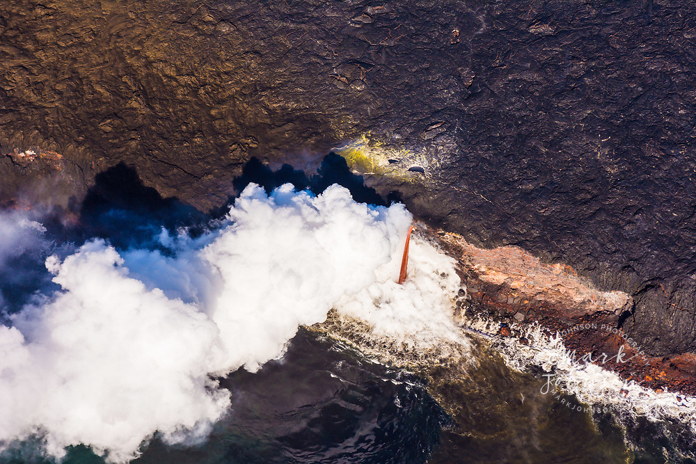 Aerial photo of the lava pouring into the sea at Kamokuna, Hawaii Volcanoes National Park, Big Island, Hawaii