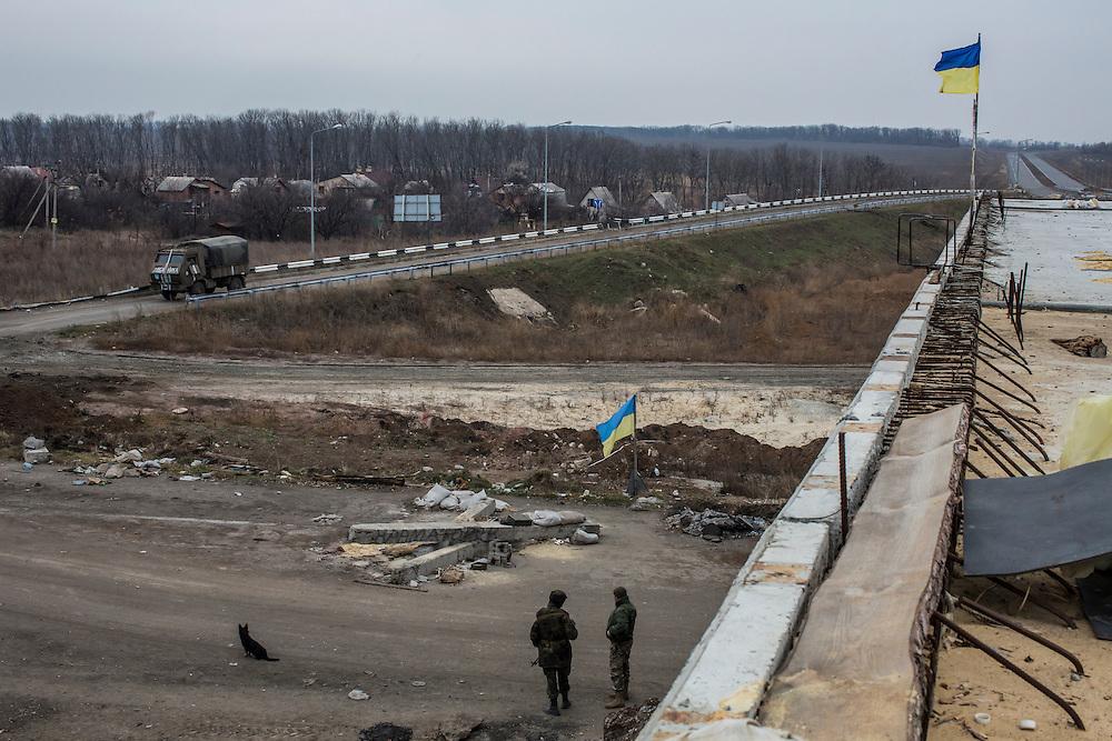 PERVOMAISKE, UKRAINE - NOVEMBER 18, 2014: Members of the 5th platoon of the Dnipro-1 brigade, a pro-Ukraine militia, at their post underneath a bridge in Pervomaiske, Ukraine. CREDIT: Brendan Hoffman for The New York Times