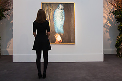 Sotheby's, Mayfair, London, November 7th 2014. Several outstanding examples of Czech avant-garde art from the Roy and Mary Cullen collection are to be auctioned by Sotheby's on November 12th. PICTURED: A woman gazes at Toyen's The Message of the Forest, which is expected to fetch up to £1 million at auction.